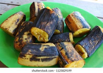 boiled bananas on green plate