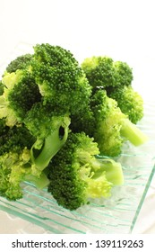 boiled broccoli on glass plate for gourmet salad image