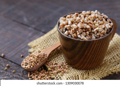 boiled buckwheat in a wooden cup, healthy food