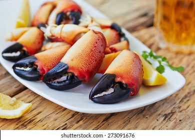 Boiled crab claws and beer