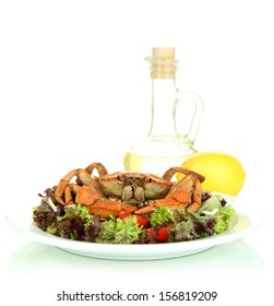 Boiled crab on white plate with salad leaves and tomatoes, isolated on white