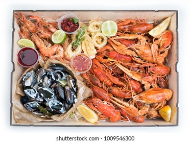 boiled crawfish, mussels, shrimps with sauces