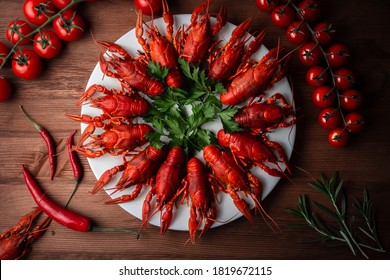 Boiled boiled crawfish on a plate. Herb-flavored crayfish