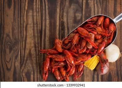 Boiled Crawfish on a Wood Background