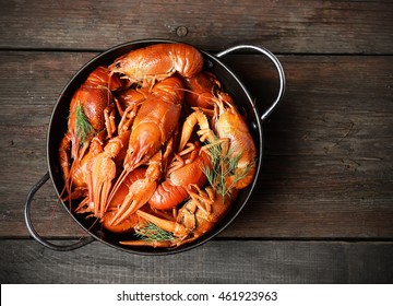 boiled crawfish in a plate  on a wooden background