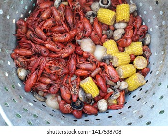 Boiled Crawfish in a Pot with Vegetables