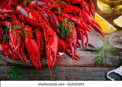 Boiled crayfish with dill  on wooden background