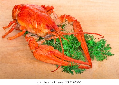 boiled crayfish with herbs on a wooden table