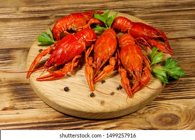 Boiled crayfish on cutting board on wooden table