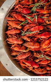 boiled crayfish on an iron plate. boiled red crayfish background for menu. top view, close up photo. a plate of cooked crayfish. Boiled crayfish, a traditional Russian dish. Hot Boiled Crawfish