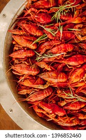 boiled crayfish on an iron plate. boiled red crayfish background for menu. top view, close up photo. a plate of cooked crayfish. Boiled crayfish, a traditional Russian dish. vintage photo processing