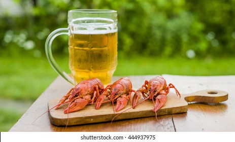 Boiled crayfish on a wooden background toning