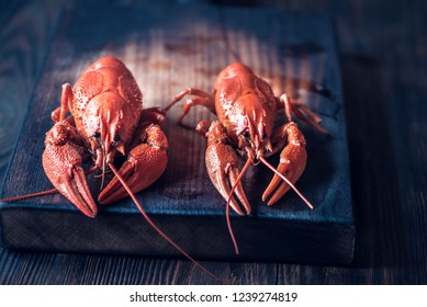 Boiled crayfish on the wooden board