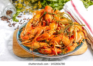 Boiled crayfish with spices. Boiled crayfish on a plate, on a concrete background. Natural product.