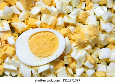 Boiled domestic egg cut in half and also sliced eggs