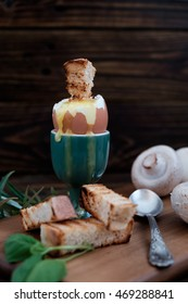 boiled egg in an eggcup and toast
