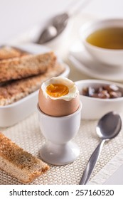 Boiled egg in eggcup with toast bread
