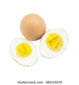 Boiled egg half cut with raw material on top view and white background