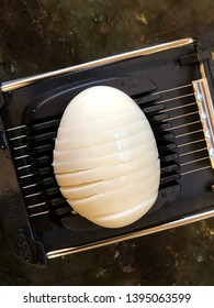 Boiled egg on a black Wire Egg Slicer