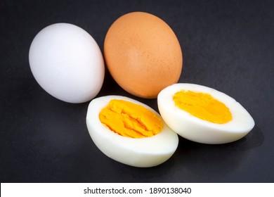 Boiled egg served on a black background
