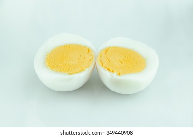 Boiled egg sliced in half on isolated background