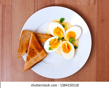 Boiled eggs with bread and mornay ssauce