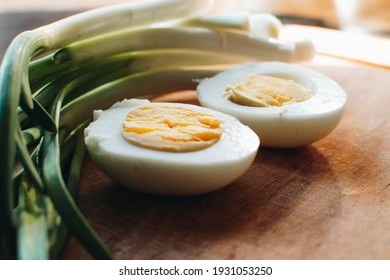 Boiled eggs with green onions. Ingredients for the spring salad. Healthy food.