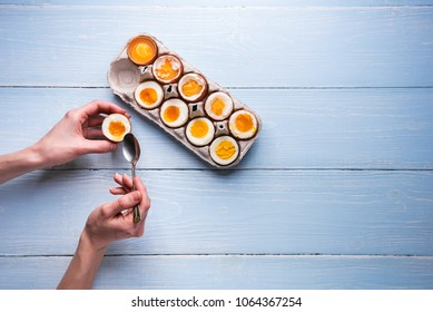 boiled eggs in hands on a wooden background