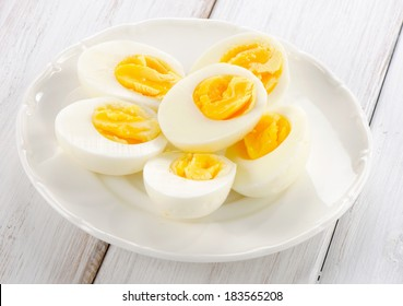 Boiled eggs on a white plate. Selective focus