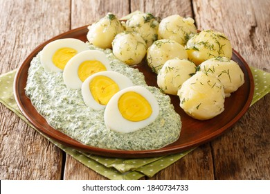 Boiled eggs and potatoes served with German green sauce close-up in a plate on the table. horizontal - Shutterstock ID 1840734733
