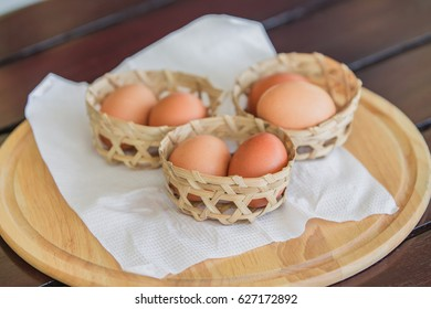 Boiled eggs are put in a basket of bamboo weaves.