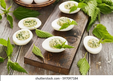 Boiled eggs stuffed with nettles on the table