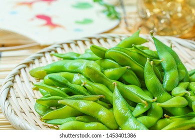 Boiled green soy beans 'Japanese Edamame' and a cold japanese tea