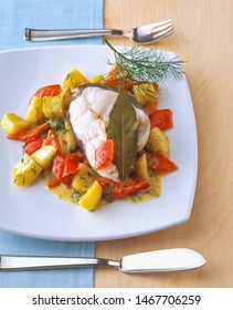 Boiled haddock fish cutlet with vegetables and mustard sauce
