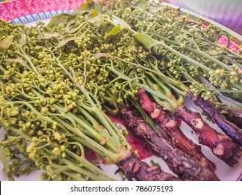 Boiled neem flower on dish for serve as local Thai vegetable. Siamese neem tree, Nim, Margosa, Quinine (Azadirachta indica A. Juss. Var. Siamensis Valeton)
