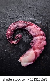 Boiled octopus ready for eat with salad leaves