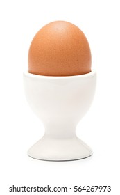 Boiled organic chicken egg in ceramic cup or holder isolated on white
