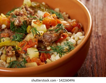 boiled pearl barley with meat and vegetable .farm-style country