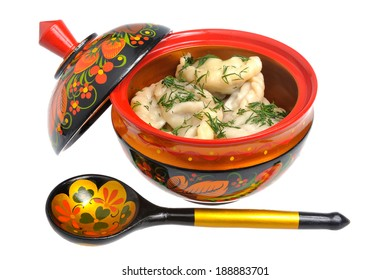 Boiled pelmeni in khokhloma painted russian wooden dish with spoon isolated on white