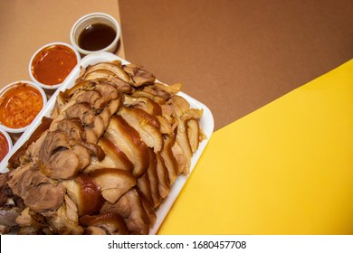 Boiled pig's trotters with sauce (Jokbal). Famous Korean food, delivery food.