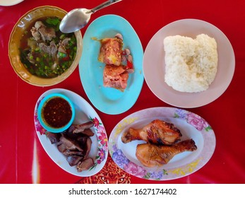Boiled pork ribs, sour pork wrapped in egg, grilled ox tongue, grilled chicken and sticky rice