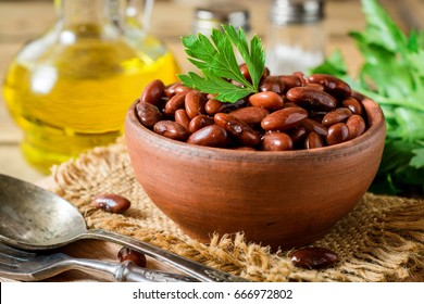 Boiled red beans in ceramic bowl. Selective focus.
