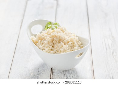 Boiled Rice in a bowl on a white table