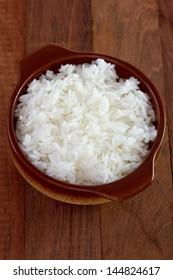 boiled rice in dark bowl