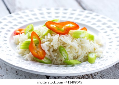 Boiled rice with fresh chilli on plate
