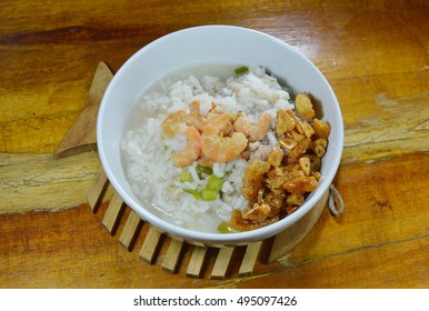boiled rice with minced pork and dried prawn topping fried garlic oil on bowl
