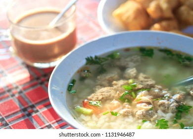 Boiled rice pork and shrimp or mush morning with coffee and deep-fried dough stick Thai style breakfast,Thai food