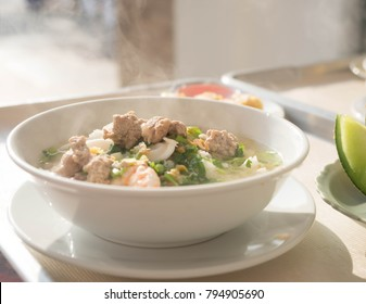 boiled rice in soup blow with shrimp and pork. Asia traditional food.