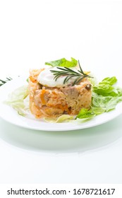 boiled rice with vegetables and fried egg with salad leaves in a plate