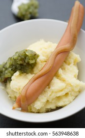 Boiled sausage with homemade mash and sweet pickle relish.